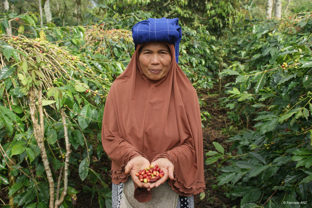 Fair trade coffee cherries and the smiling woman who grew them on the Rosette Network